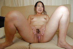 Shy asian MILF with tiny tits strips down and has some pussy toying fun