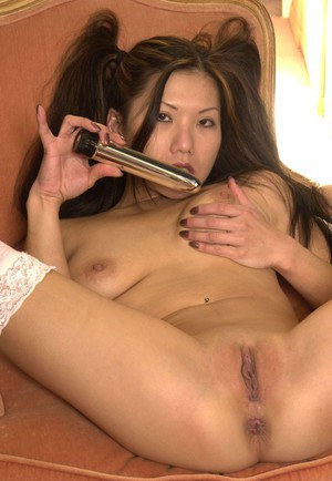 Asian floosie in nylons undressing and playing with a vibrator