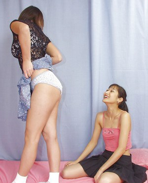Lecherous asian lassies have some stripping and lesbian humping fun