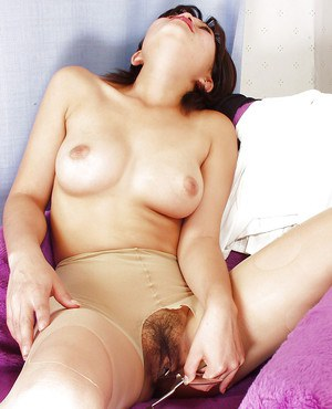 Nasty asian chick ripping her pantyhose and playing with scissors