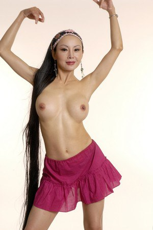 Asian vixen with big tits and shaved slit undressing and spreading her legs