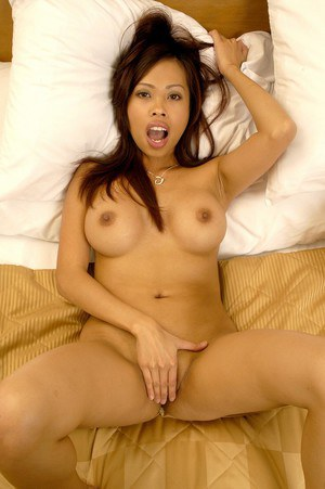 Busty asian chick with shaved cooter posing completely naked