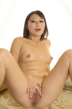 Nude thai babe with tiny tits teasing her cock-hungry shaved pussy