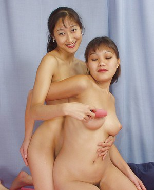 Lecherous and fuckable thai lesbians playing with their new sex toy