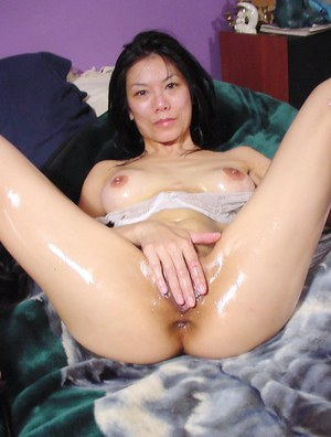 Sultry thai seductress taking off her lingerie and fingering her juicy cunt