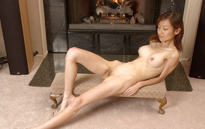 Skinny thai floosie slipping off her sexy lingerie and spreading her legs