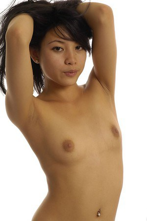Slipppy thai floosie with pierced belly button slipping off her bikini