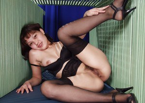Nasty thai gal in lingerie and nylons revealing her tits and hairy cunt