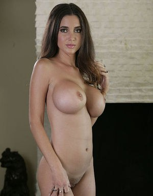 Graceful cutie with amazing round boobies slipping off her clothes