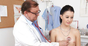 Skinny brunette gets her love holes examed by a naughty doctor