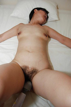 Mature Asian slut  with hairy cunt gets stimulated by big vibrator