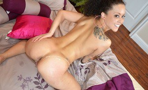 Ebony hottie with shaved cunt gets shagged and jizzed over her round fanny