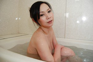 Lecherous asian MILF taking shower and rubbing her soapy curves