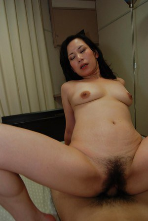 Mature asian slut gives a blowjob with ball licking and gets screwed