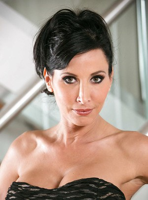 Cute, sultry, dark-haired wife Lezley Zen teases her own big tits