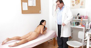 Slim brunette gets her pussy stretched with gyno's fingers and a speculum