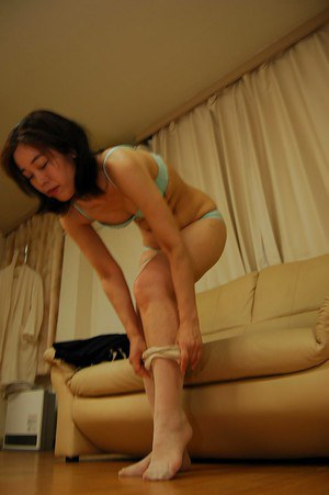 Shy asian MILF in nylons slowly getting rid of her clothes