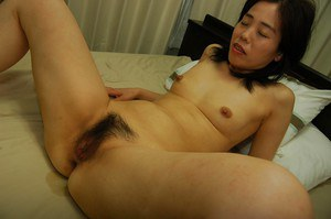 Slutty asian MILF gets her hairy pussy pleased with toys and a stiff cock
