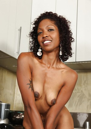 Mature ebony whore Lotus Lain poses in kitchen and gets very wet