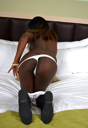 Smiley ebony girl getting naked and pleasing her cunt with a vibrator