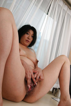 Fatty mature asian slut undressing and toying her shaggy twat