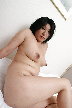 Naughty mature asian lassie undressing and spreading her shaggy pussy lips