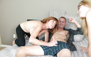 Slutty mom teaching her naughty daughter how to handle with a stiff cock