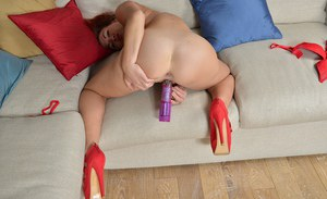 Arrogant mature redhead Jazz is masturbating with huge sex toys