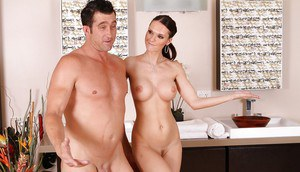 Tall busty vixen gives an erotic massage ending with cum on her face