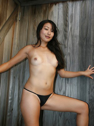 Lusty asian amateur in high heels revealing her tits and inviting pussy