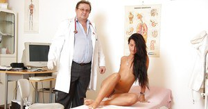 Fuckable brunette with trimmed pubis going through full gyno examination