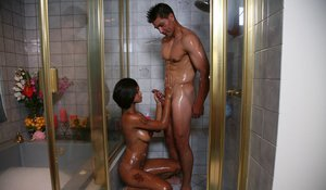 Ebony masseuse with big jugs pleasing her client with her hands and feet