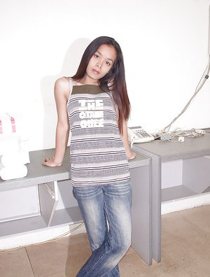 Petite asian girlie with hairy cooter undressing and spreading her legs