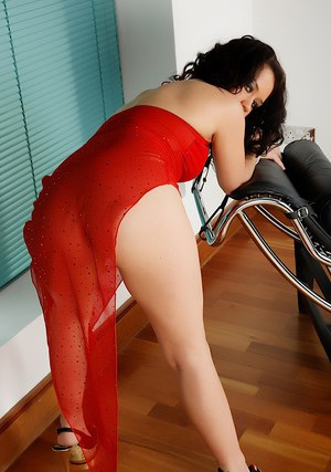 Naughty brunette slipping off her red lingerie and teasing her pierced pussy