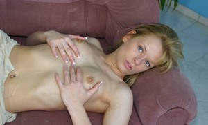 Slim blonde sweetie with tiny tits undressing and fingering her pussy