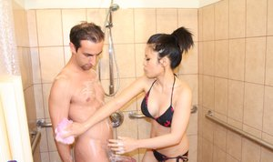 Teasing Asian massage girl Sasha baths with throbbing bush beater