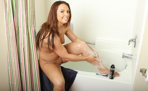 Smiley amateur with ample ass shaving her legs and exposing her goods