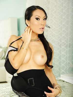 Luscious asian temtress in nylons revealing her tits and cooter