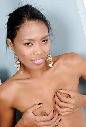 Smiley exotic amateur gets rid of her clothes and exposes her slim body