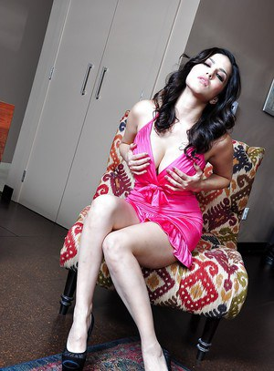 Jaw-dropping sexy brunette in pink dress uncovering her bosoms and honey pot