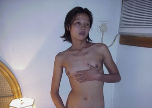 Skinny Asian slut exposes her cleanly shaved kitten and pussy lips