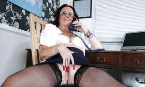 Mature secretary Zadi in sexy glasses and stockings becomes wild alone