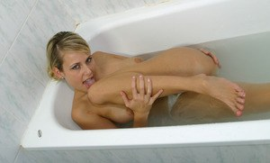 Amateur blonde Renata wets her big boobs in shower and poses naked