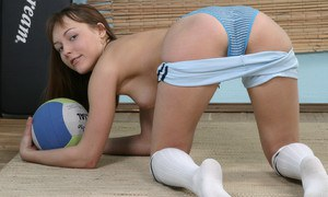 Clothed chick with an sweet teen body Marina likes spreading her legs
