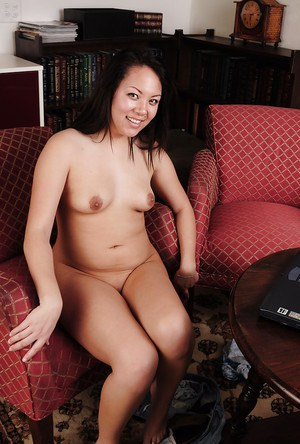 Brunette Asian Tina is being filmed in close up while wearing sexy dress