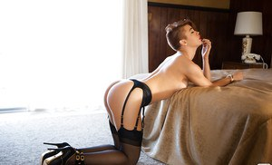 Stockings model Britt Linn is showing her new outfit on camera