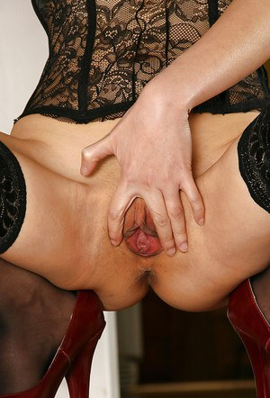 Awesome amateur Asian babe Angel shows off her shaved pussy