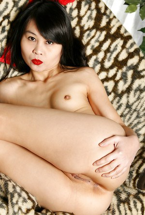 Asian babe with tiny tits Angel is demonstrating her new lingerie