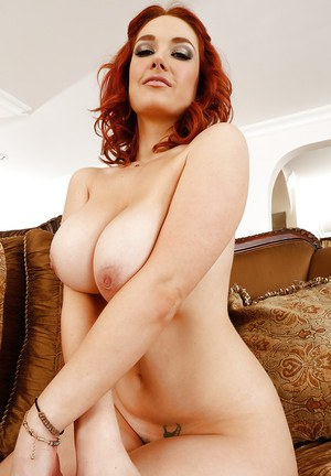 Sexy redhead Siri is undressing her tight shirt for her fans
