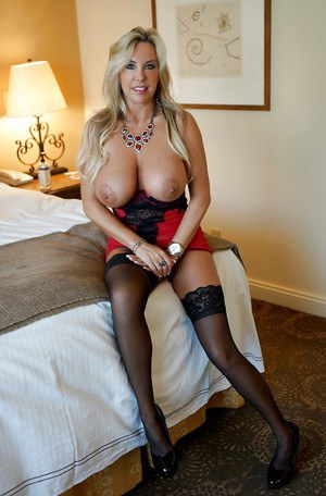 Fascinating busty blonde wife Sandra Otterson poses in sexy lingerie